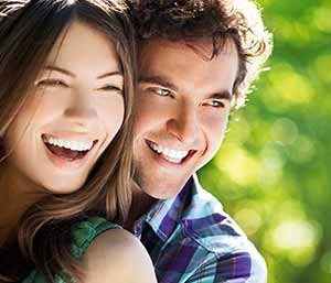 Image of a couple smilling showing their brighter teeth